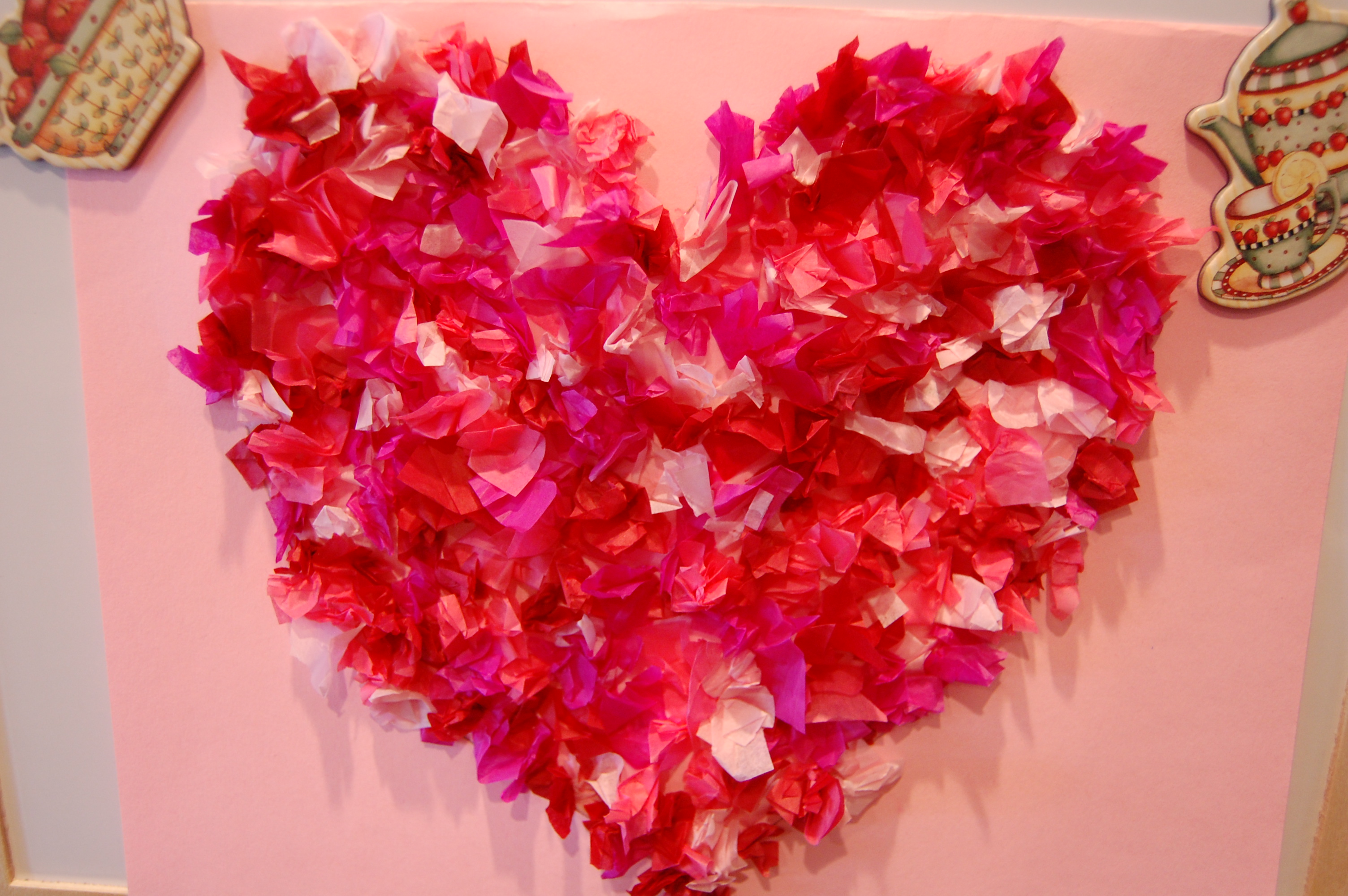 her tissue paper valentines heart art i asked her who she would gift it to and after a few seconds of thought she said it was for me sniff